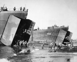 Australian troops disembarking from American Landing Ships, Tank (LST)