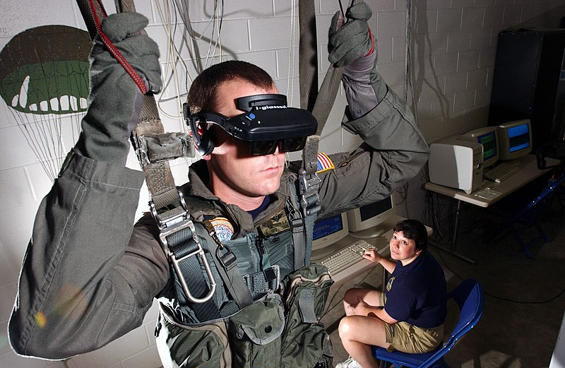 Soldier in a parachute simulator wearing virtual reality glasses